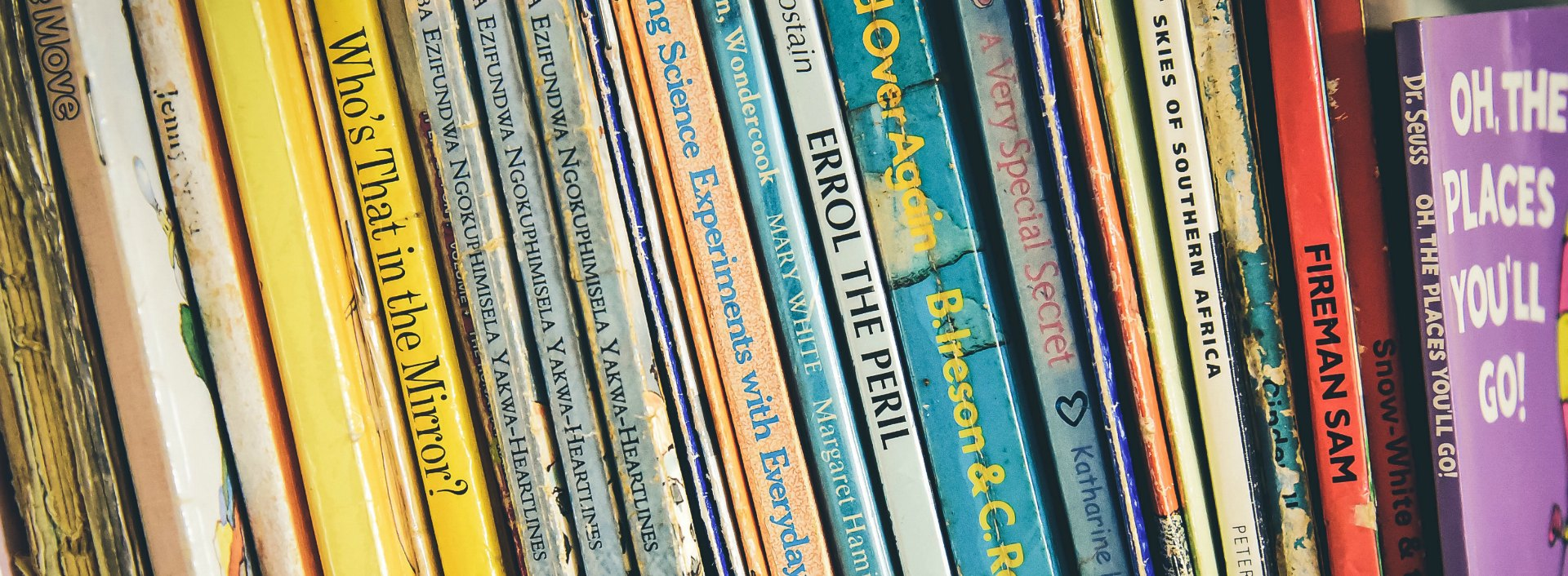 Books to Improve English sitting on a shelf.