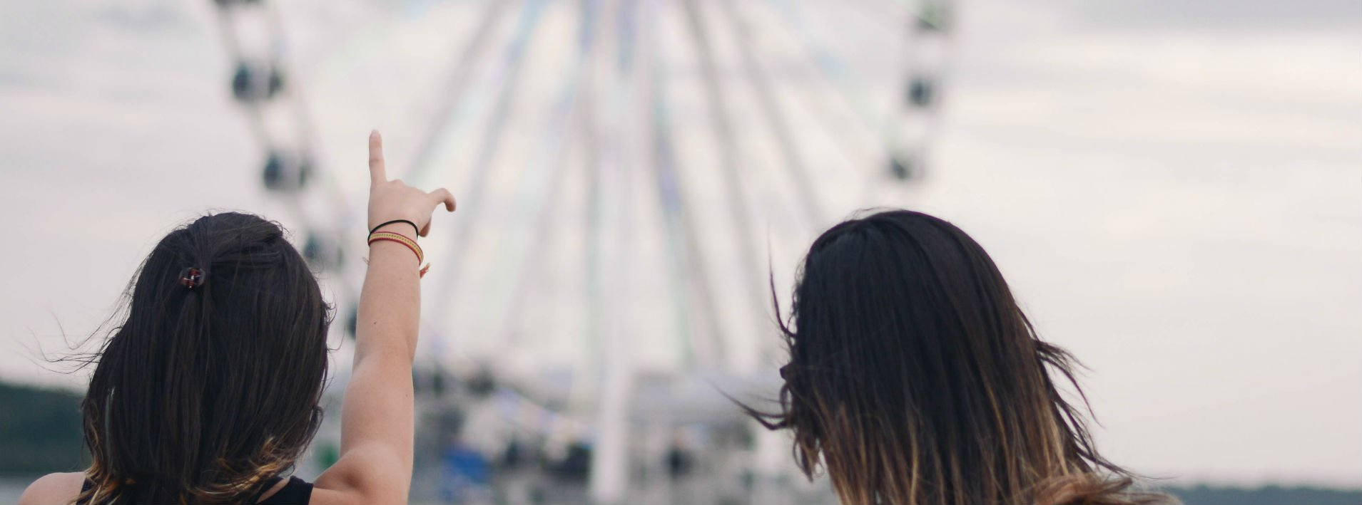 Girl pointing to a ferris wheel in the background- When to use This, That, These, and Those.