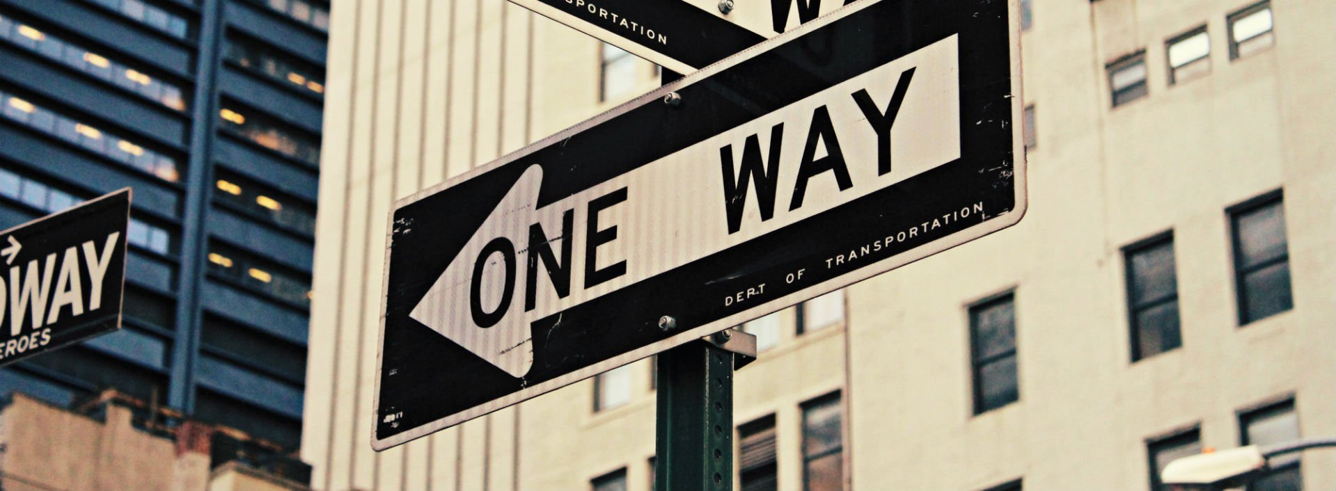 """Give Directions in English to Someone- a sign that is pointing left with the words """"one way"""" on it."""