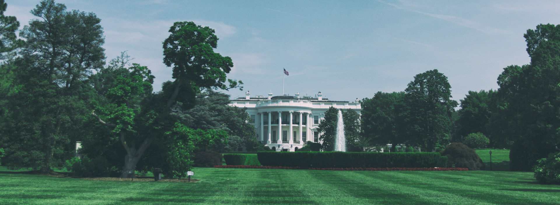 The White House represents the government, one of many collective nouns in English.