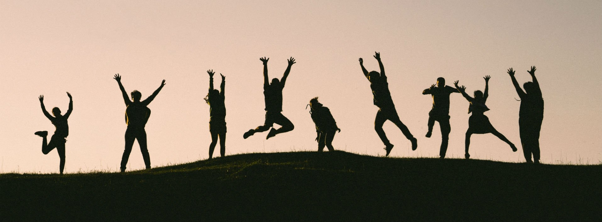 Were, where: We're here to help: People jumping up on a mountain in a shadow form.