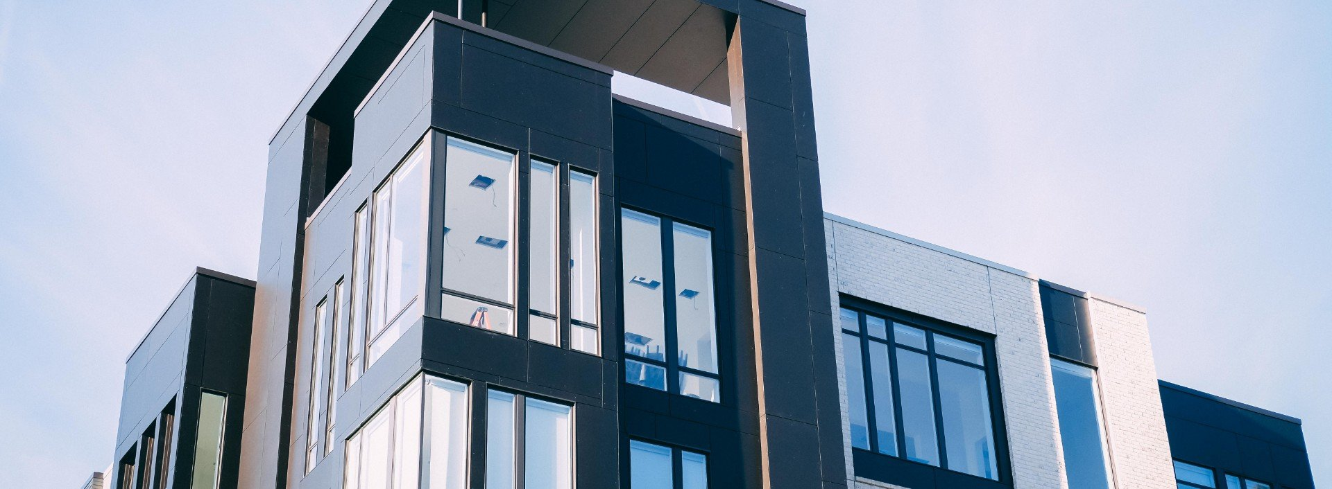 Modern apartment building with large glass windows- English for renting an apartment