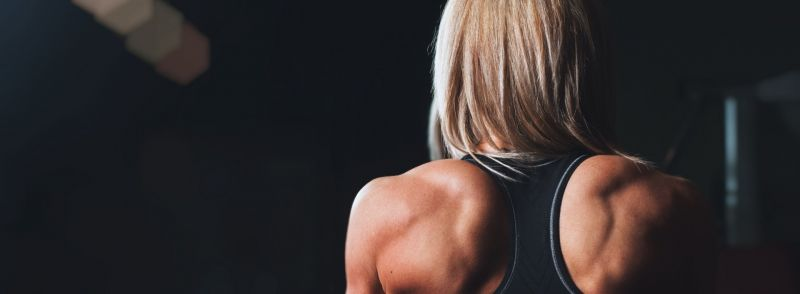 A woman with very defined back and shoulder muscles for root word fort
