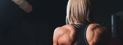 The back of a woman with very strong back and shoulder muscles: root word fort