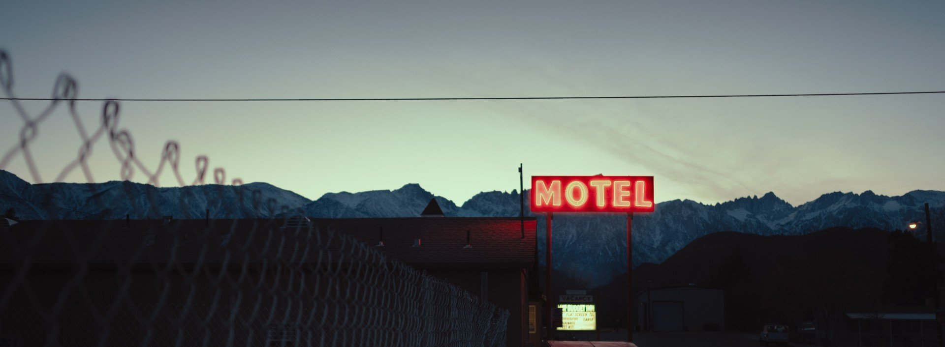 A picture from a distance of sign that says Motel, one many blended words in English