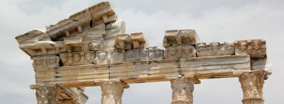Close up of a ruined facade of a greek temple, idioms from Greek Mythology