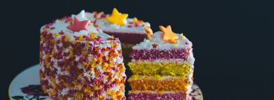 A several-layer cake, a piece of cake is coming out of the rest, food idioms in English