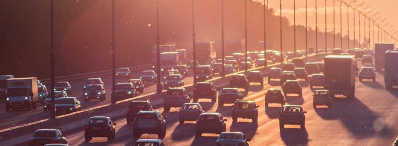 Transportation collocations: to sit in traffic on a freeway, several lanes of cars are driving during rush hour.