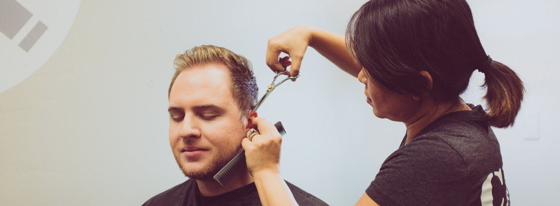 Vocabulary for the Hairdresser: a man getting his hair cut.