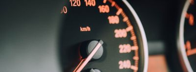 A speedometer in kilometers per hour is shown glowing orange, in Car Parts in English -- Part 2.