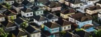 House idioms: Rows of multi-colored houses in a neighborhood are seen from above.