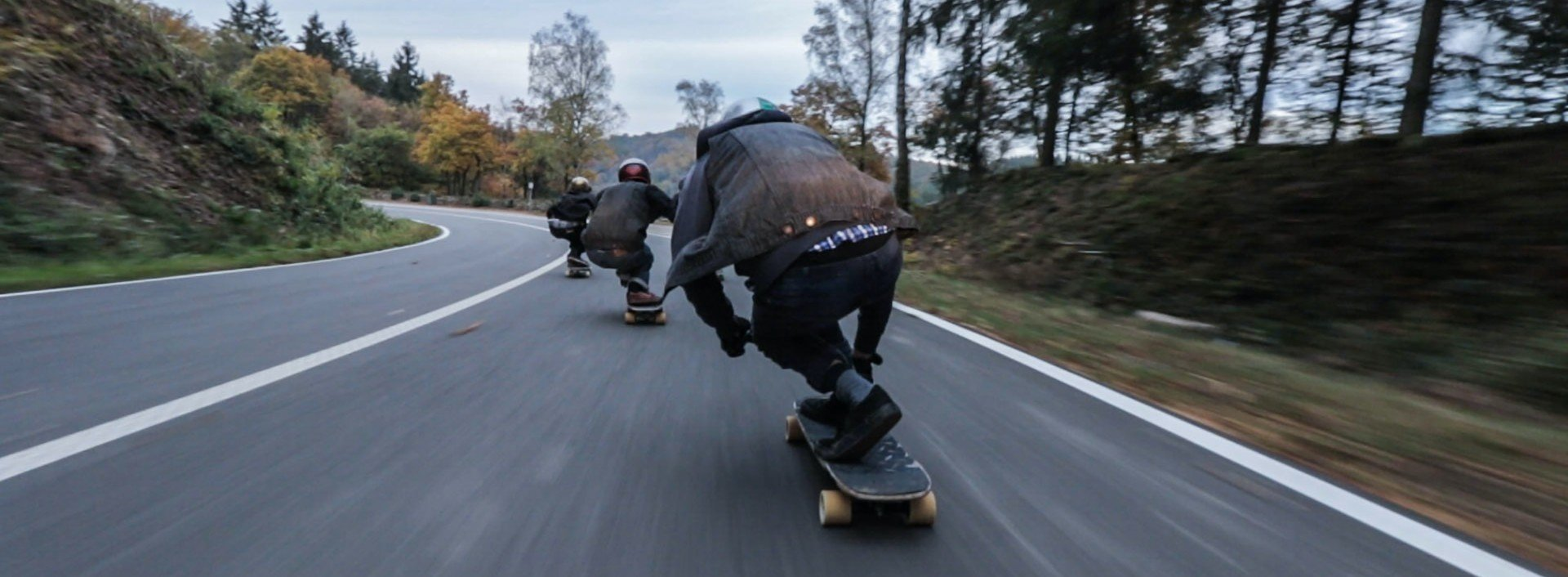 Contronyms: three skateboarders skate down a hill very fast (which is a word that has two separate meanings).