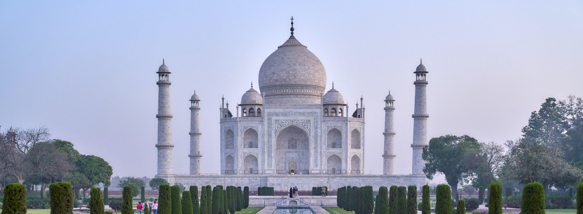 Hindi loan words: The Taj Mahal, a famous landmark in India, is shown at sunset with no people around.