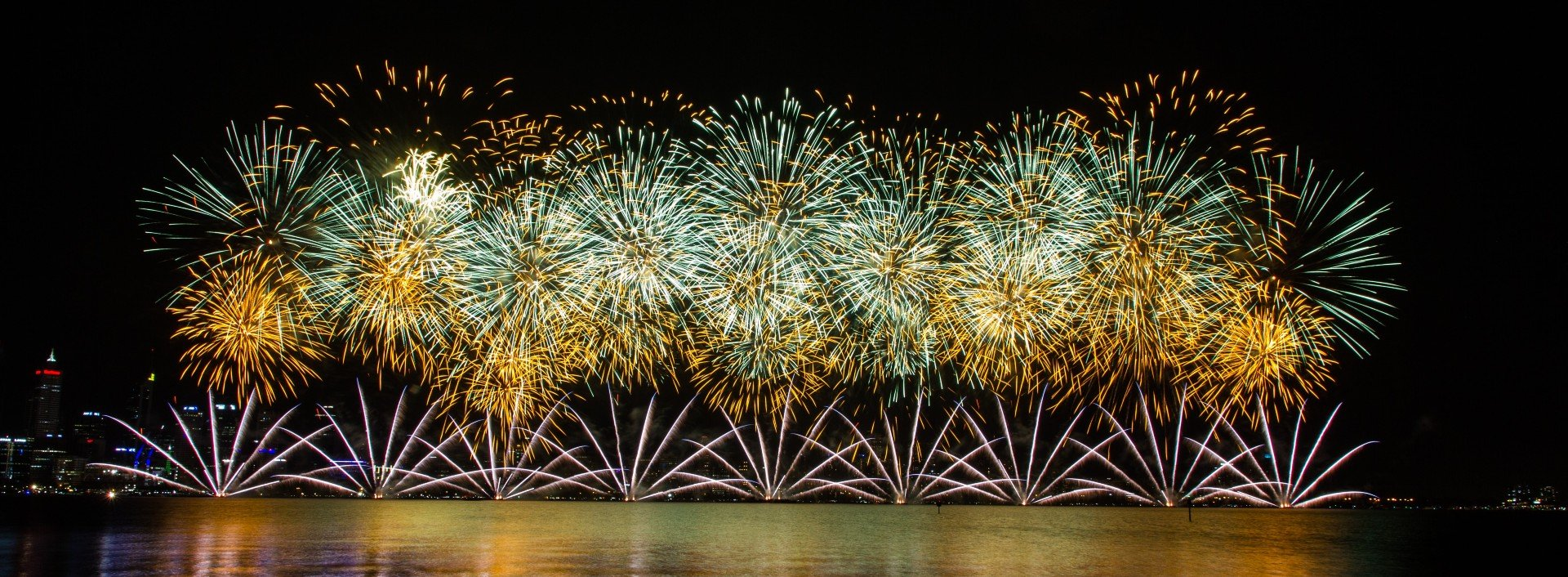 Phrasal verb to go off: Fireworks go off over a body of water.