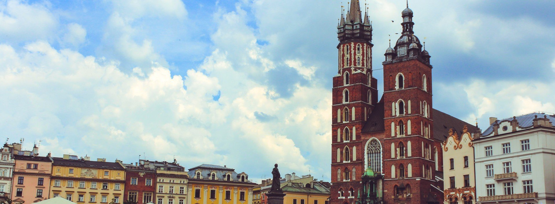 Polish Loan Words in English: the town square and church in Krakow, Poland is pictured on a sunny day.
